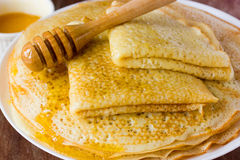 Traditional yeast pancakes with honey Royalty Free Stock Photo
