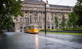 Traditional yellow hungarian tram in the square Royalty Free Stock Images