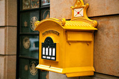 A traditional yellow letter box in Germany. Communication between people, sending letters and receiving messages. Dresden Stock Photos