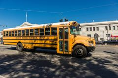 Traditional yellow school bus on a street in San Francisco, California, USA royalty free stock image