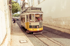 Traditional yellow tram downtown Lisbon Stock Photo