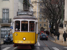 Traditional yellow trams in Lisbon Stock Photos