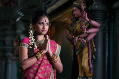 Traditional Young indian girl praying Stock Photos