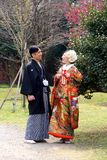 Traditional Young Japanese couple out for a stroll in the park in downtown Tokyo Stock Photo