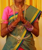South Indian Bride Dressed In Traditional Bridal Costume Doing Namaste. Traditional young women Bridal Costume Doing Namaste stock photos