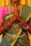 South Indian Bride Dressed In Traditional Bridal Costume Doing Namaste. Traditional young women Bridal Costume Doing Namaste stock photography