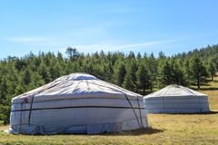 Traditional yurts in Mongolia. A traditional yurt (from Turkic) or ger (Mongolian) is a portable, round tent covered with skins or felt used as a dwelling by Stock Photos