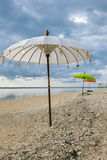 Traditionall colored Balinese umbrellas on the beach of Gili Air Royalty Free Stock Photos