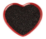 Traditionally Chinese black Rice in red heart. Shaped plate, isolated over white Stock Photos