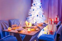 Traditionally Christmas table setting with Christmas tree Stock Images