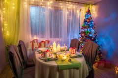 Traditionally Christmas table setting during the frosty winter evening. Closeup of traditionally Christmas table setting during the frosty winter evening Stock Photo
