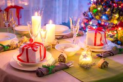 Traditionally Christmas table setting with green and white decoration Royalty Free Stock Image