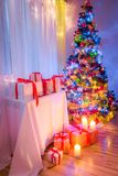 Traditionally Christmas tree with gifts for Christmas eve. Closeup of traditionally Christmas tree with gifts for Christmas eve Stock Photo
