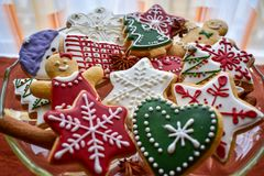 Traditionally decorated Christmas gingerbread cookies on a blass bowl stock image