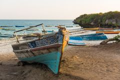 Traditional Swahili fisherboat at Malindi beach. A traditionally decorated fisherboat in Swahili style rests on a idyllic beach of the touristic town of Malindi Stock Images