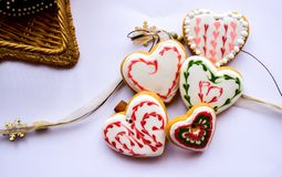 Traditionally decorated heart shaped Christmas gingerbread cookies background stock images