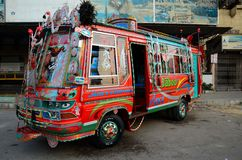 Traditionally decorated Pakistani bus art Karachi Pakistan. Karachi, Pakistan - February 22, 2015: An ornately painted and decorated passenger minibus stands on Stock Photos