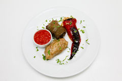 Traditionally dish. Stuffed pepper, vine and cabbage rolls with tomato chutney Stock Photos