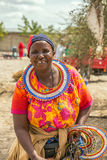 Traditionally dressed african woman selling merchandise, Arusha Royalty Free Stock Image