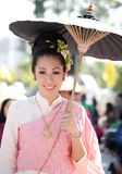 Traditionally dressed girl in procession Stock Photos