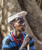 Traditionally dressed Hamar man with chewing stick in his mouth. Turmi, Omo Valley, Ethiopia Royalty Free Stock Photo
