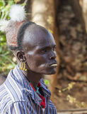 Traditionally dressed Hamar man with chewing stick in his mouth. Turmi, Omo Valley, Ethiopia. Stock Images