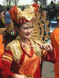 Traditionally dressed Indonesian girl. Performing in a colorful art festival in Java, Indonesia Stock Photo