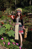 Traditionally dressed Mhong hill tribe woman in the garden. At mountain royalty free stock photo