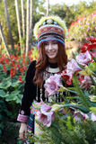 Traditionally dressed Mhong hill tribe woman in the garden. At mountain stock photos