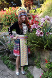 Traditionally dressed Mhong hill tribe woman in the garden. At mountain stock photo