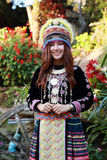 Traditionally dressed Mhong hill tribe woman in the garden. At mountain stock images