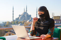 Traditionally dressed Muslim Woman working on computer Stock Photo