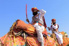 Traditionally dressed Rajastani men on camels Royalty Free Stock Photography