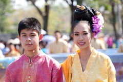 Traditionally dressed smiling man and woman Stock Images
