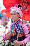 Traditionally dressed smiling young woman. CHIANG MAI, THAILAND - FEBRUARY 4: Traditionally dressed smiling young woman under umbrella on Chiang Mai 36th Flower Royalty Free Stock Photos