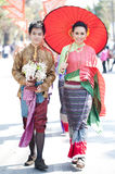 Traditionally dressed Thai couple. CHIANG MAI, THAILAND - FEBRUARY 4: Traditionally dressed Thai couple in procession on Chiang Mai 36th Flower Festival on Royalty Free Stock Image
