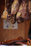 Traditionally homemade cured meat, smoked, hanged in the market. And sausages Stock Photography