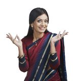 Traditionally Indian woman gesturing. Portrait of a Traditionally Indian woman gesturing Royalty Free Stock Images
