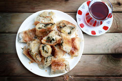 Traditionally Kol boregi. Kol boregi Arm borek is a Turkish puff pastry prepared in long rolls, traditionally filled with cheese, potatoes, spinach, or meat, and Royalty Free Stock Images