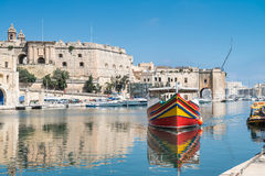 Traditionally painted passenger boat in Vittoriosa royalty free stock image