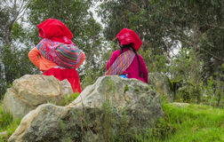 Traditionaly dressed latin american women in the village area Royalty Free Stock Photo