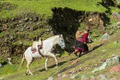 Traditionaly dressed latin american women in the village with horse Stock Photography