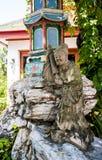 Traditioneel Chinees stijlstandbeeld in de Tuindecoratie stock foto