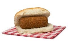 Traditioneel wit broodje met een Nederlandse geroepen kroket, broodje kroket royalty-vrije stock afbeelding
