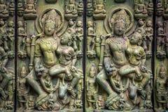 Traditionele Aziatische steengravure van Boeddhismedeities die Aziatische cultuur en Aziatische snijdende ambacht illustreren royalty-vrije stock afbeeldingen