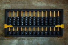 Traditionele Chinese Calculator op een Oud houten Comité Stock Foto