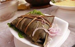 Traditionele Peruviaanse tamale of 'tamal ' stock fotografie