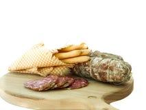 Traditionele salami met brood-stokken Stock Afbeelding