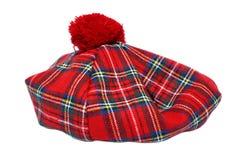 Traditionele Schotse Rode Geruit Schots wollen stofbonnet royalty-vrije stock afbeeldingen