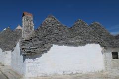 Traditionele witte trulligebouwen Stock Foto